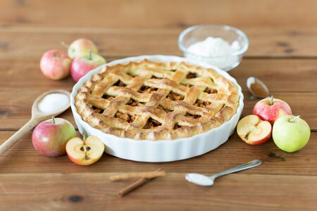 Photo for close up of apple pie on wooden table - Royalty Free Image