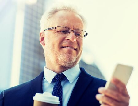 Photo pour businessman with smartphone and coffee in city - image libre de droit