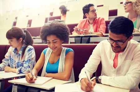 Photo for Group of students with notebooks in lecture hall - Royalty Free Image
