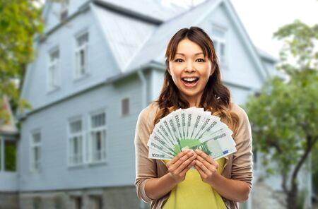 Photo pour Asian woman with hundred euro money banknotes - image libre de droit