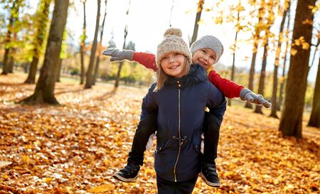 Photo for Happy children having fun at autumn park - Royalty Free Image