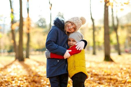 Photo for happy children hugging at autumn park - Royalty Free Image