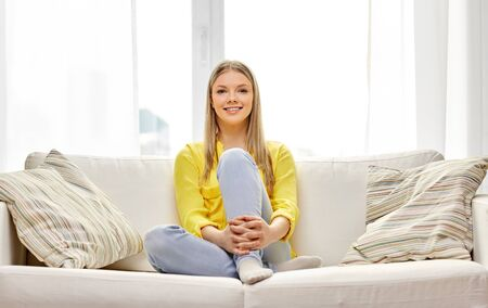 Photo for young woman or teenage girl on sofa at home - Royalty Free Image