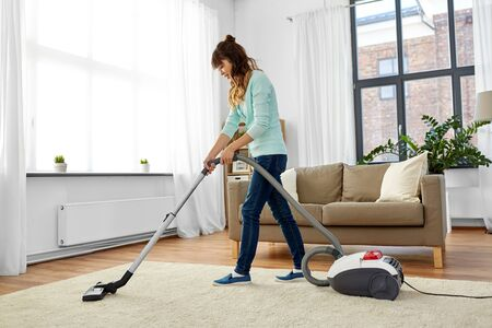 Photo for asian woman with vacuum cleaner at home - Royalty Free Image