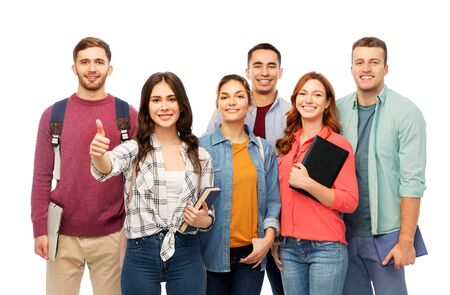 Photo pour group of smiling students showing thumbs up - image libre de droit