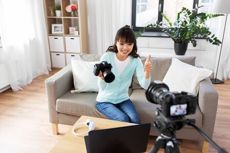 Photo for asian female blogger with camera recording video - Royalty Free Image
