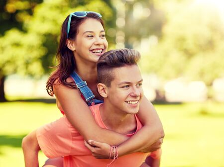Foto de happy teenage couple having fun at summer park - Imagen libre de derechos