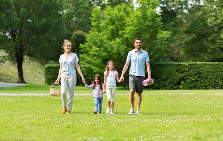 Photo for family with picnic basket walking in summer park - Royalty Free Image