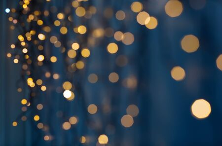 Photo for christmas garland lights over dark blue background - Royalty Free Image