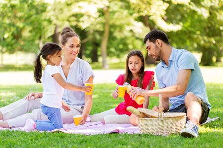 Photo for family drinking juice on picnic at summer park - Royalty Free Image