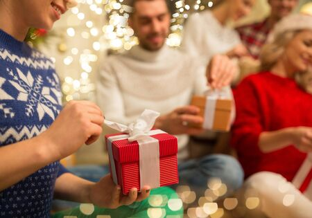 Photo for close up of friends opening christmas gifts - Royalty Free Image