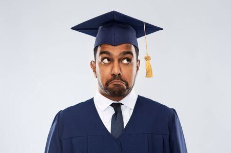 confused indian graduate student in mortar board