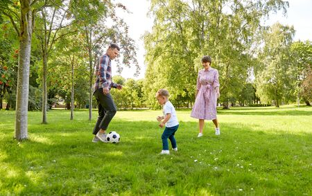 Foto de happy family playing soccer at summer park - Imagen libre de derechos