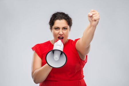 woman in red dress speaking to megaphone