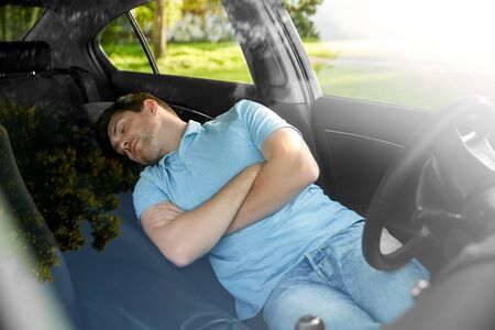 Photo for transport, rest and driving concept - tired man or driver sleeping in car - Royalty Free Image