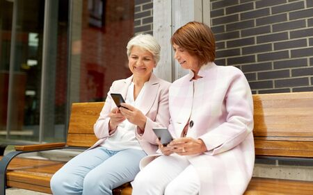 Photo for happy senior women with smartphones in city - Royalty Free Image