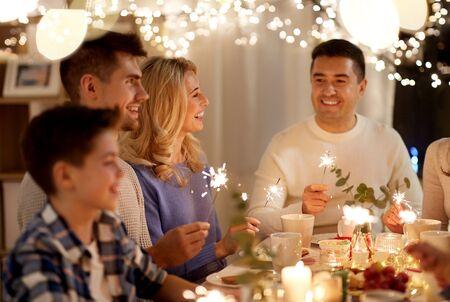 Photo pour family with sparklers having tea party at home - image libre de droit