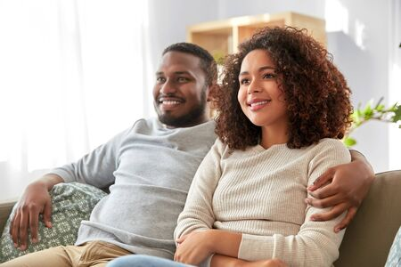 Photo for happy african american couple hugging at home - Royalty Free Image