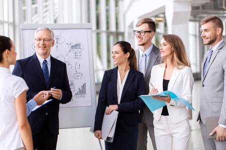 Photo pour business team with scheme on flip chart at office - image libre de droit