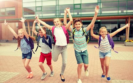 Photo for group of happy elementary school students running - Royalty Free Image