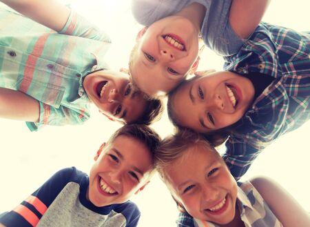Photo pour group of happy children faces in circle - image libre de droit