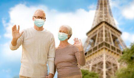 Photo pour old couple in protective medical masks in france - image libre de droit