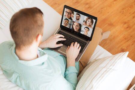 Foto de man with laptop having video call with colleagues - Imagen libre de derechos