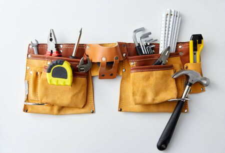 Photo for different work tools in belt on white background - Royalty Free Image