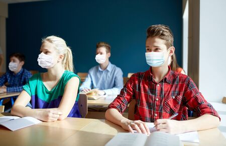 Photo for group of students in masks at school lesson - Royalty Free Image