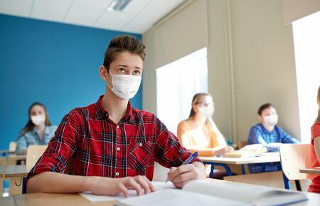 Foto für group of students in masks at school lesson - Lizenzfreies Bild
