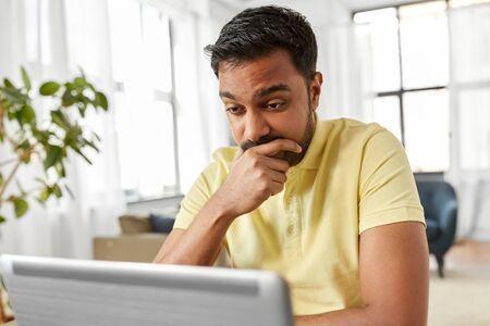 Photo pour indian man with laptop working at home office - image libre de droit