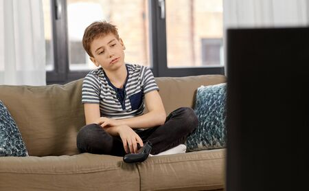 Photo pour sad boy with gamepad playing video game at home - image libre de droit