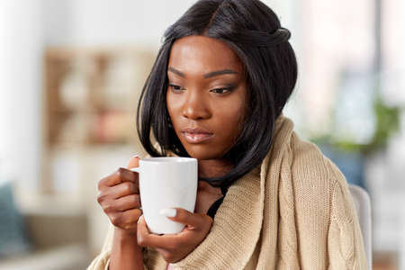 Photo for sick african amercian woman drinking tea at home - Royalty Free Image