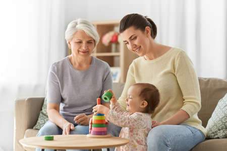 Photo for mother, baby daughter and granny playing at home - Royalty Free Image