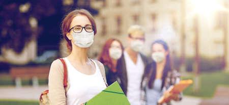 Photo pour teenage student girl in mask with school friends - image libre de droit