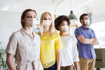 Photo pour business team in masks in office - image libre de droit