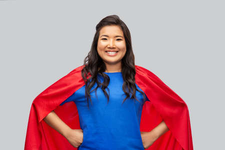 Photo for happy asian woman in red superhero cape - Royalty Free Image