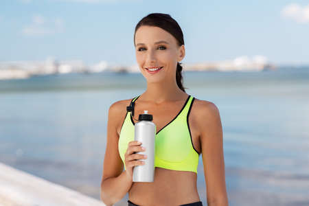 Photo pour woman drinking water from bottle after sports - image libre de droit
