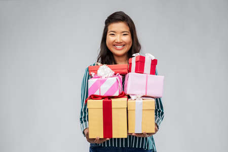 Photo for happy asian woman with birthday presents - Royalty Free Image
