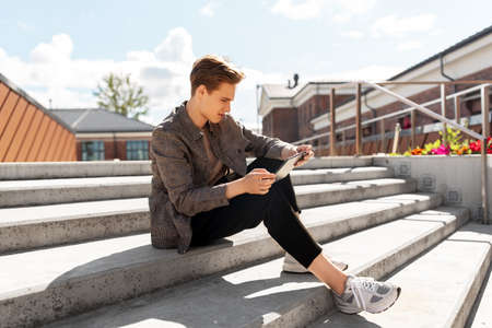 Photo for young manor teenage boy with tablet pc in city - Royalty Free Image