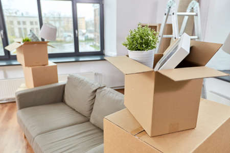 Photo for sofa and corrugated boxes with stuff at new home - Royalty Free Image