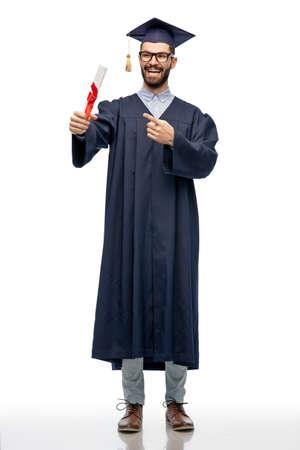 Photo pour male graduate student in mortar board with diploma - image libre de droit