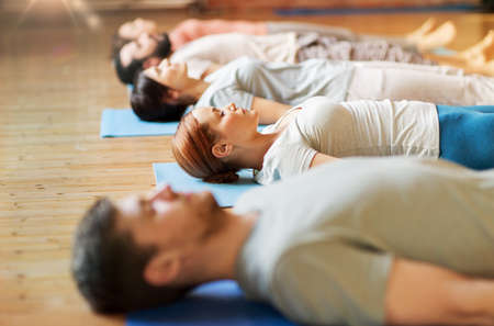 Photo for group of people making yoga exercises at studio - Royalty Free Image