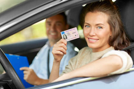 Photo for car driving instructor and driver with license - Royalty Free Image