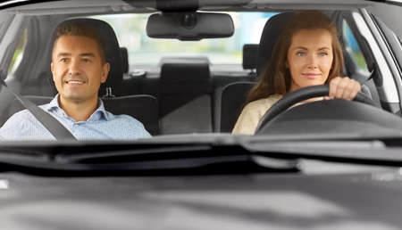 Photo for car driving school instructor teaching woman - Royalty Free Image