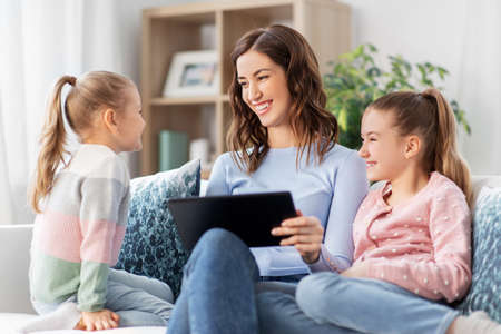 Photo for happy mother and daughters with tablet pc at home - Royalty Free Image