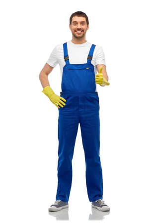 Photo pour happy male worker or cleaner in overall and gloves - image libre de droit