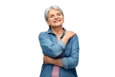 Photo pour portrait of smiling senior woman in denim shirt - image libre de droit