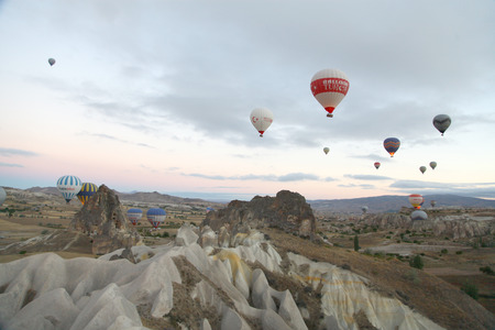 Multi-coloured hot air balloons floating and flying in the air.