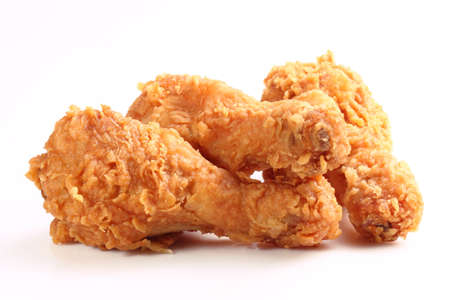 Three hot and crispy fried chicken legs on a white background